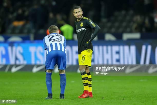 MitchellElijah Weiser of Hertha speaks with Jeremy Toljan of Dortmund during the Bundesliga match between Hertha BSC and Borussia Dortmund at...