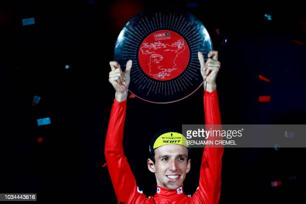 MitcheltonScott's British cyclist Simon Philip Yates celebrates on the podium after winning the 73rd edition of La Vuelta Tour of Spain cycling race...