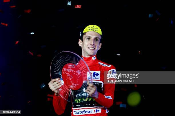 TOPSHOT MitcheltonScott's British cyclist Simon Philip Yates celebrates on the podium after winning the 73rd edition of La Vuelta Tour of Spain...