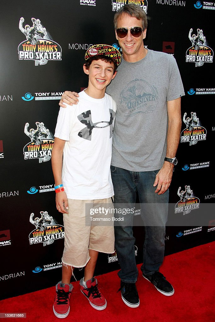 Mitchie Brusco (L) and Tony Hawk attend the 9th annual Tony Hawk Stand Up For Skateparks Benefit held at Ron Burkle's Green Acres Estate on October 7, 2012 in Beverly Hills, California.