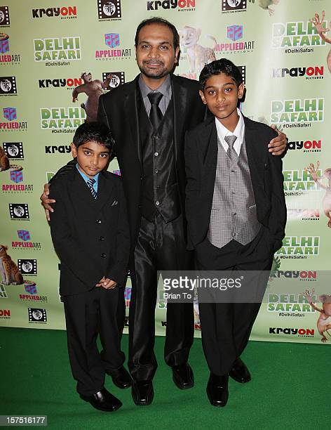Mitesh Kumar Patel and children attend 'Delhi Safari' Los Angeles premiere at Pacific Theatre at The Grove on December 3 2012 in Los Angeles...