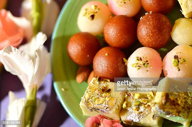 mithai (traditional south asian sweets) - mithai stock pictures, royalty-free photos & images
