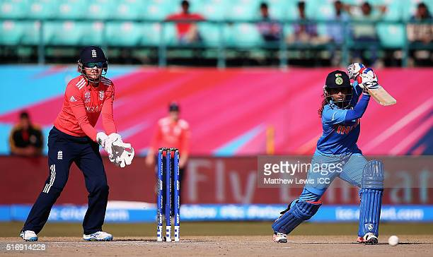 Mithali Raj Captain of India hits the ball towards the boundary as Sarah Taylor of England looks on during the Women's ICC World Twenty20 India 2016...