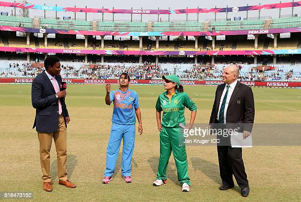 Mithali Raj Captain of India toss the coin with Sana Mir Captain of Pakistan Pommie Mbangwa and match referee Andy Pycroft looking on during the...