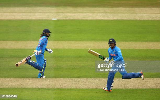 Mithali Raj of India and Veda Krishnamurthy of India add more runs to the total during the ICC Women's World Cup match between India and New Zealand...