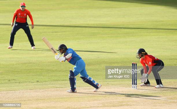 Mithali Raj of India bats with Amy Jones wicket keeper of England looking on during the warm up match between England and India ahead of the ICC...