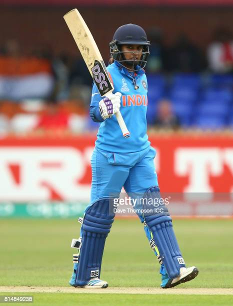 Mithali Raj of India celebrates making fifty not out during the ICC Women's World Cup match between India and New Zealand at The 3aaa County Ground...