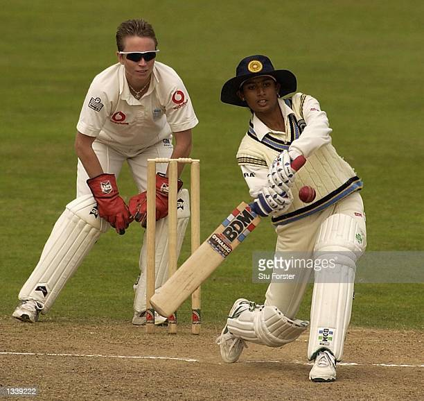 Mithali Raj of India hits out watched by England wicketkeeper Mandie Godliman during the Second Day of the Second Test Match between England and...