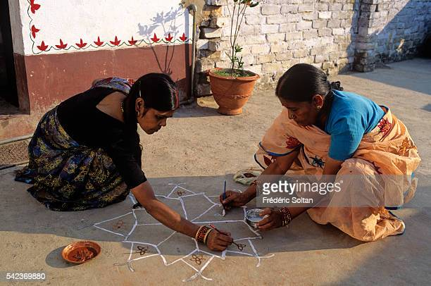 Mithila is also the name of a style of Hindu art created in the Mithila area Women illustrate traditional ritual Mithila decorations depictions of...