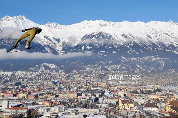 Mitja Meznar of Slovenia competes during the training round of the FIS Ski Jumping World Cup event at the 60th Four Hills ski jumping tournament at...