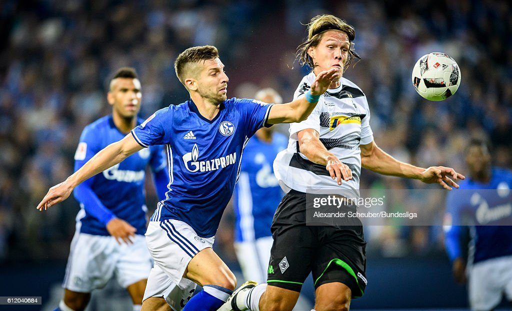 Mitja Nastasic of Schalke challenges Jannik Verstergaard of Borussia Moenchengladbach during the Bundesliga match between FC Schalke 04 and Borussia Moenchengladbach at Veltins-Arena on October 2, 2016 in Gelsenkirchen, Germany.