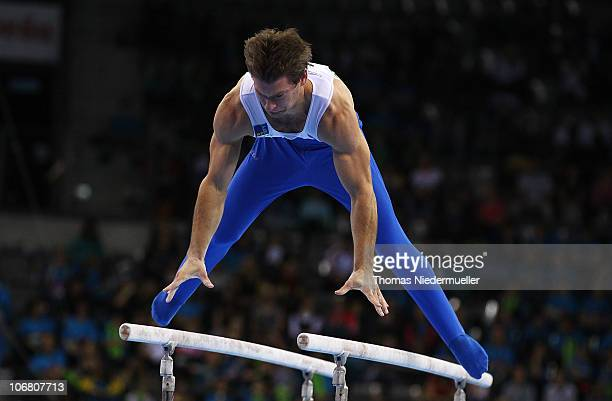 Mitja Petkovsek of Slowenia performes at the parallel bars during the EnBW Gymnastics Worldcup 2010 at the Porsche Arena on November 13 2010 in...