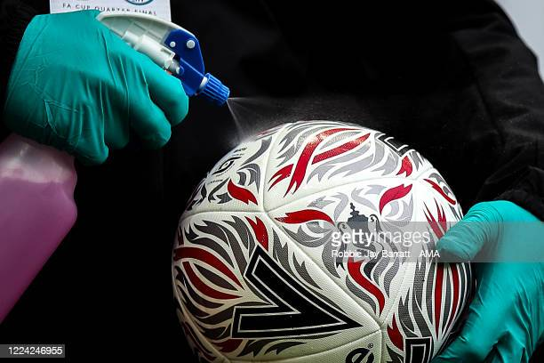 Mitre Emirates FA Cup Match ball is disinfected during the FA Cup Quarter Final match between Newcastle United and Manchester City at St James Park...