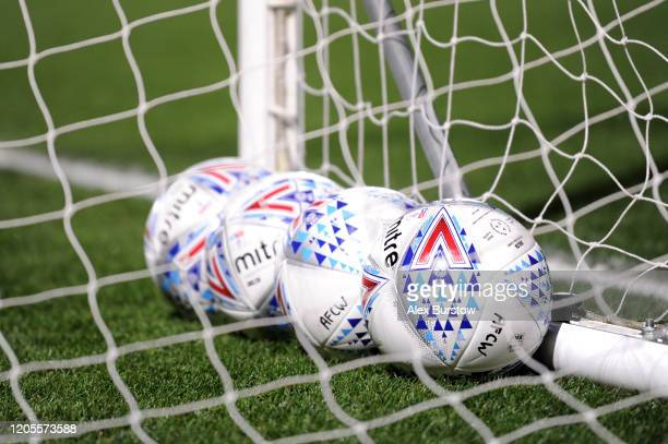 Mitre training balls are seen inside a goal net prior to the Sky Bet League One match between AFC Wimbledon and Ipswich Town at The Cherry Red...
