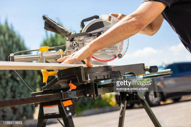 mitre trim saw used by mature adult male working on home remodel project photo series - mitre stock pictures, royalty-free photos & images