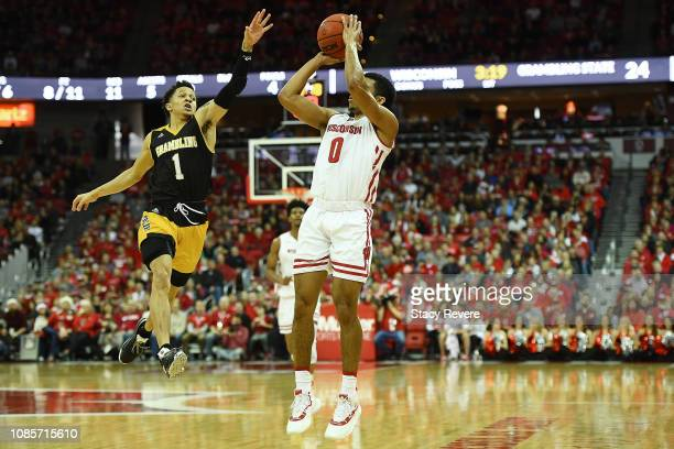 Mitrik Trice of the Wisconsin Badgers shoots over Ivy Smith Jr. #1 of the Grambling State Tigers during the first half at Kohl Center on December 22,...