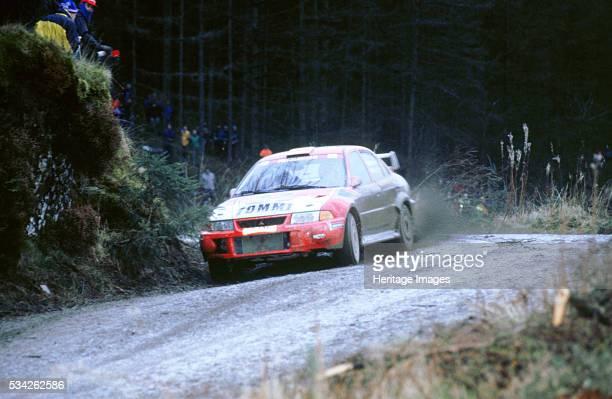 Mitsubish Lancer Evo driven by Timo Makinen1999 network Q 2000