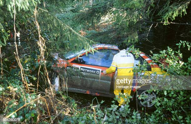 Mitsubish Lancer Evo ends up in treesdriven by GCox1998 Network q rally 2000