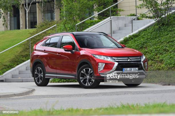 mitsubishi eclipse cross on the street - mitsubishi group stock pictures, royalty-free photos & images