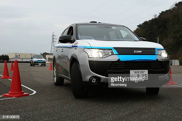 A Mitsubishi Electric Corp selfdriving vehicle travels though a test course during a demonstration in Ako Hyogo Prefecture Japan on Friday March 18...
