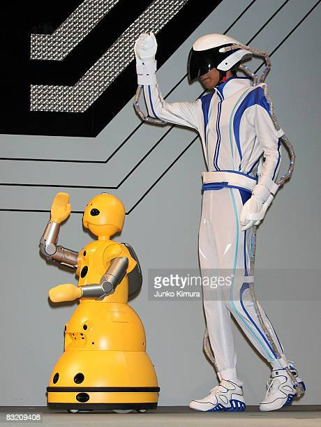 Mitsubishi Heavy Industries' robot Wakamaru copies the movement of a man wearing sensor tubes on his body during the Robo_Japan 2008 Press Preview at...