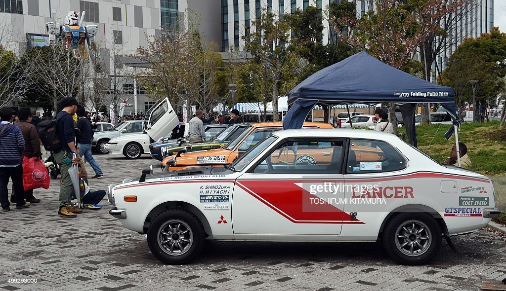 Mitsubishi Lancer A72 rally car is displayed with other vintage cars ...