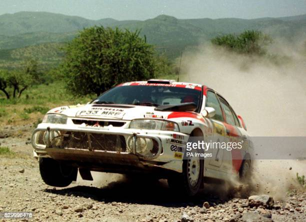 Mitsubishi Lancer driven by Britain's Richard Burns in action during the Safari Rally in Nairobi today This year's Safari was the shortest in the...
