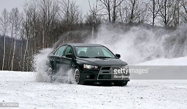 Mitsubishi Lancer Evolution MR is driven on a snowy skid pad at Team O'Neil Rally School Car Control Center in Dalton New Hampshire US on Friday Feb...