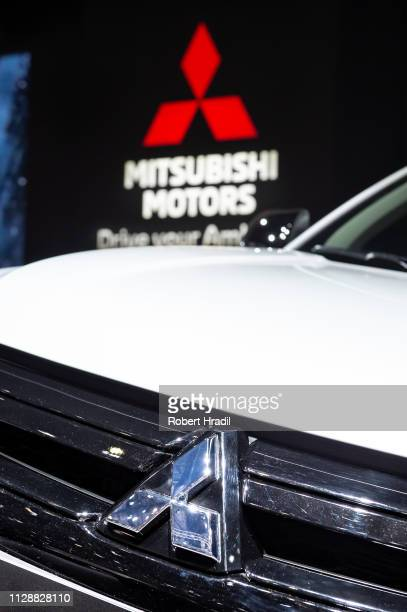 Mitsubishi logo is displayed during the second press day at the 89th Geneva International Motor Show on March 6, 2019 in Geneva, Switzerland.