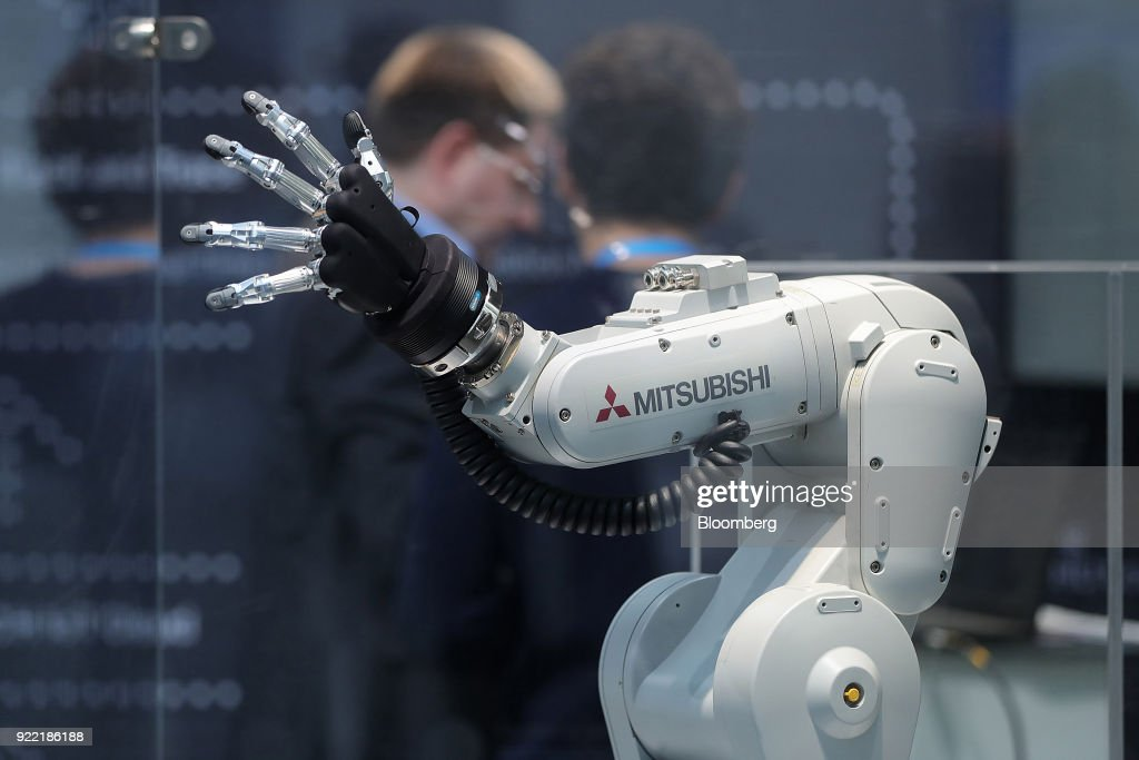 A Mitsubishi Melfa robotic arm, manufactured by Mitsubishi Electric Corp., stands on display at the Robert Bosch GmbH Internet of Things (IoT) conference in Berlin, Germany, on Wednesday, Feb. 21, 2018. Bosch raked in record profit and revenue last year and foresees more growth in 2018 even as the German auto-parts giant wrestles with weakness in the scandal-beset diesel segment that might be compounded by controversial air-quality tests on monkeys. Photographer: Krisztian Bocsi/Bloomberg via Getty Images