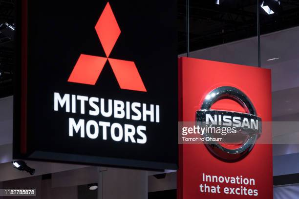 Mitsubishi Motors Corp. And Nissan Motor Co. Logos are displayed at the Tokyo Motor Show on October 23, 2019 in Tokyo, Japan. The auto show takes...