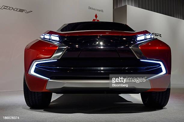 A Mitsubishi Motors Corp Concept XRPHEV vehicle stands on display at an unveiling in Tokyo Japan on Friday Nov 1 2013 Mitsubishi Motors unveiled the...