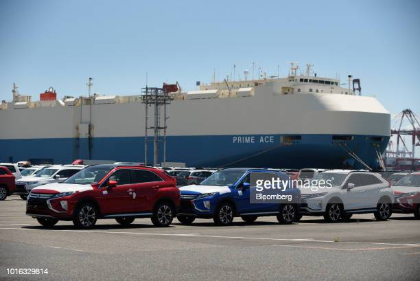 Mitsubishi Motors Corp Eclipse Cross vehicles bound for shipment stand at the Nagoya Port in Nagoya Japan on Tuesday July 31 2018 Japan is scheduled...