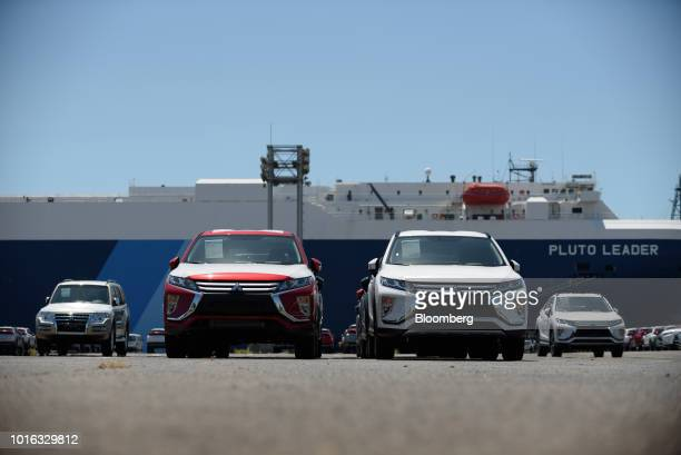 Mitsubishi Motors Corp vehicles bound for shipment stand at the Nagoya Port in Nagoya Japan on Tuesday July 31 2018 Japan is scheduled to release...