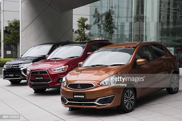 Mitsubishi Motors Corp vehicles stand on display outside the company's headquarters in Tokyo Japan on Tuesday Aug 2 2016 An investigation of...