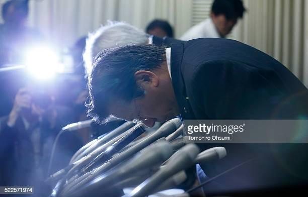 Mitsubishi Motors President Tetsuro Aikawa bows during a press conference on April 20 2016 in Tokyo Japan Mitsubishi Motors share plunged more than...