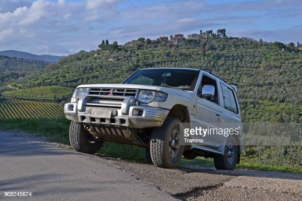 mitsubishi pajero driving on the road - mitsubishi group stock pictures, royalty-free photos & images