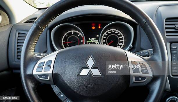 mitsubishi steering wheel and dashboard - mitsubishi group stock pictures, royalty-free photos & images