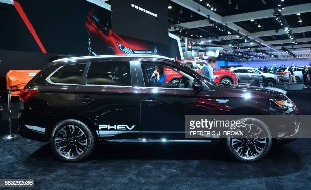 Mitsubishi's 2018 Outlander PlugIn Hybrid Electric Vehicle is displayed at the 2017 LA Auto Show in Los Angeles California on November 30 which opens...