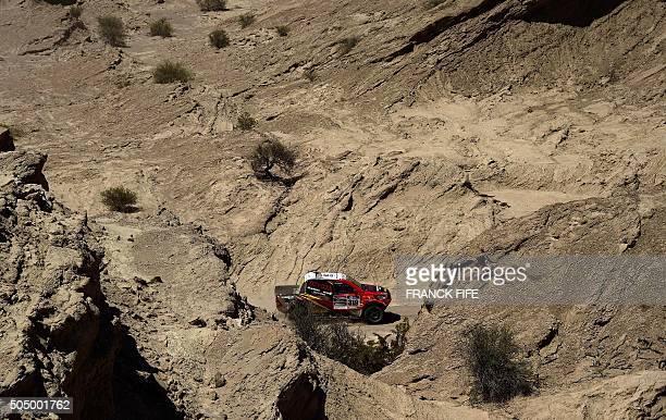 TOPSHOT Mitsubishi's Portuguese Carlos Souza and codriver Paulo Fiuza compete during the Stage 11 of the Rally Dakar 2016 between La Rioja and San...