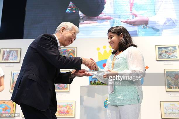 Mitsuhisa Kato Executive Vice President Member of the Board of Directors Toyota Motor Corporation gives Engineering Inspiration Award to Minhal Adnan...