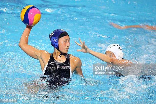 Mitsuki Hashiguchi of Japan shoots for goal in the Women's Single Round Robin Waterpolo during day five of the 2014 Asian Games at Dream Park...