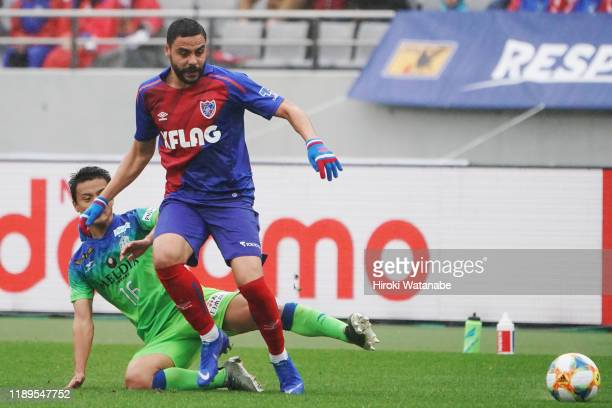 Mitsuki Saito of Shonan Bellmare and Diego Oliveira of FC Tokyo compete for the ball during the J.League J1 match between FC Tokyo and Shonan...
