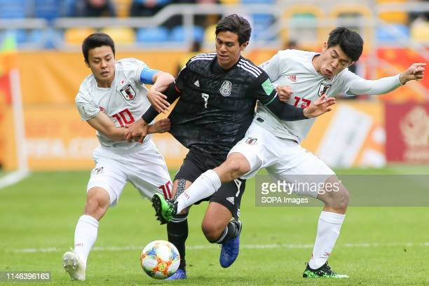Mitsuki Saito , Taisei Miyashiro from Japan and Jose Macias from Mexico are seen in action during the FIFA U-20 World Cup match between Mexico and...