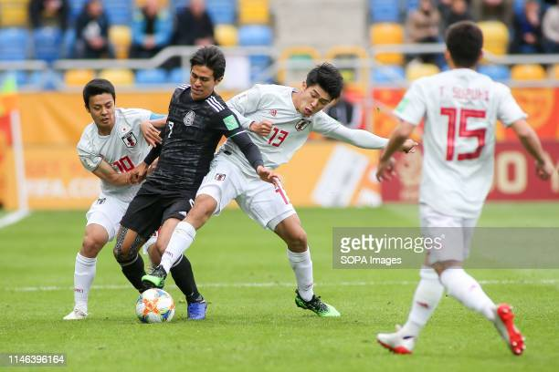 Mitsuki Saito Taisei Miyashiro from Japan and Jose Macias from Mexico are seen in action during the FIFA U20 World Cup match between Mexico and Japan...
