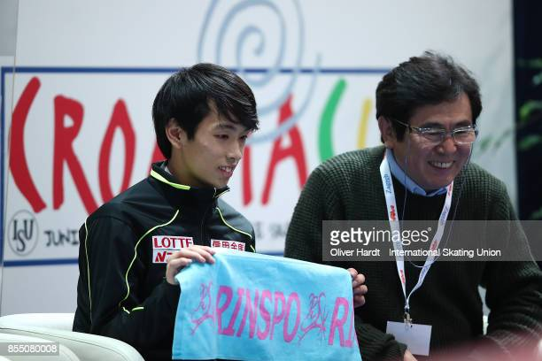 Mitsuki Sumoto of Japan look on at the kiss and cry in the Junior Men Short Program during day two of the ISU Junior Grand Prix of Figure Skating at...