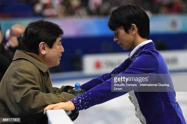 Mitsuki Sumoto of Japan talks to his coach before his routine in the Junior men free skating during the ISU Junior Senior Grand Prix of Figure...