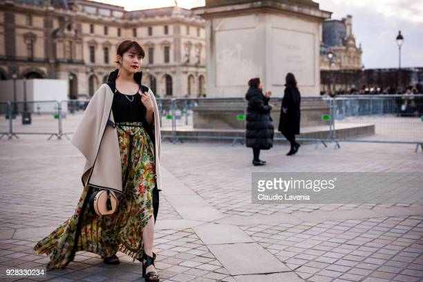 Mitsuki Takahata is seen in the streets of Paris before the Louis Vuitton show during Paris Fashion Week Womenswear Fall/Winter 2018/2019 on March 6...