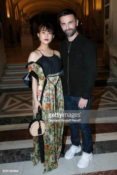 Mitsuki Takahata Stylist Nicolas Ghesquiere pose after the Louis Vuitton show as part of the Paris Fashion Week Womenswear Fall/Winter 2018/2019 on...