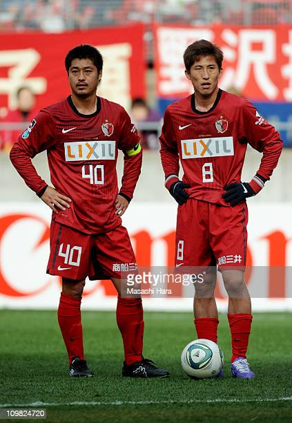 Mitsuo Ogasawara and Takuya Nozawa of Kashima Antlers during JLeague match between Kashima Antlers and Omiya Ardija at Kashima Stadium on March 6...